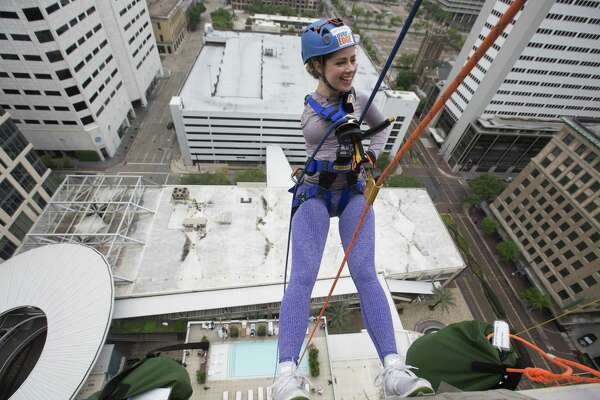 Faith Malton is excited to propel down from the 21st floor of Hotel Alessandra on Saturday, April 13, 2019, in Houston. The 22-year-old University of Houston student was born with one arm and participated in the annual fundraiser to raise money for Special Olympics.