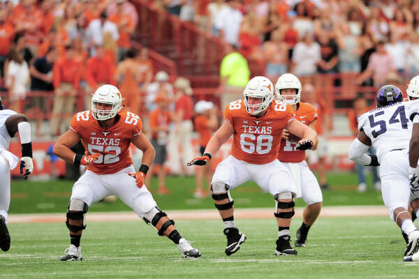 AUSTIN, TX - SEPTEMBER 22: Texas Longhorn linemen Derek Kerstetter (68) and Sam Cosmi (52) block during the 31 - 16 win over the TCU Horned Frogs on September 22, 2018, at Darrell K Royal-Texas Memorial Stadium in Austin, Texas. (Photo by John Rivera/Icon Sportswire via Getty Images)