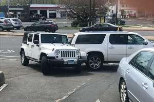 Police investigate a parking accident next to the Bull's Head United State's Post Office where a woman was run over by her own large SUV early Friday afternoon.