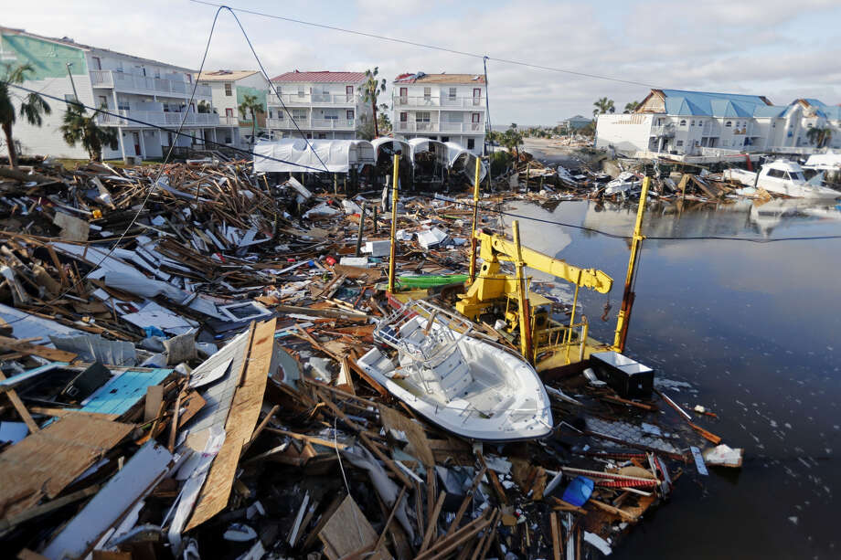 A boat sits amidst debris in the aftermath of Hurricane Michael in Mexico Beach, Fla. Weather forecasters have upgraded last fall's Hurricane Michael from a Category 4 storm to a Category 5. The National Oceanic and Atmospheric Administration announced the storm's upgraded status Friday, making Michael only the fourth storm on record to have hit the U.S. as a Category 5 hurricane. Photo: AP File Photo
