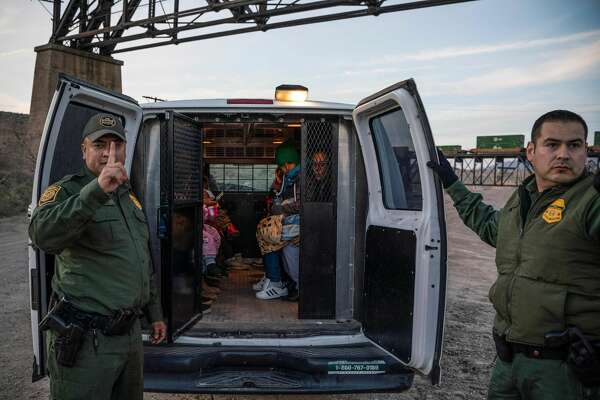 "A group of about 30 Brazilian migrants, who had just crossed the border, get into a US Border Patrol van, taking them off the property of Jeff Allen, who used to run a brick factory near Mt. Christo Rey on the US-Mexico border in Sunland Park, New Mexico on March 20, 2019. - The militia members say they will patrol the US-Mexico border near Mt. Christo Rey, ""Until the wall is built."" In recent months, thousands of Central Americans have arrived in Mexico in several caravans in the hope of finding a better life in the United States. US President Donald Trump has branded such migrants a threat to national security, demanding billions of dollars from Congress to build a wall on the southern US border. (Photo by Paul Ratje / AFP)PAUL RATJE/AFP/Getty Images"