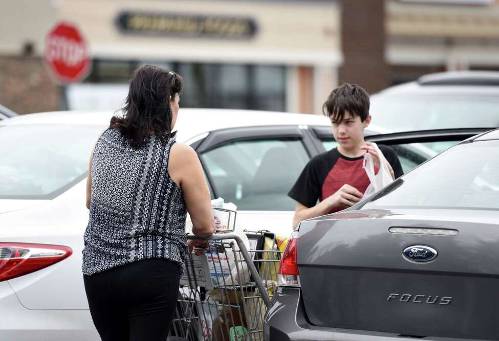 Lori Caulford and her son Ryan Caulford, 13, put their groceries in their car on Friday, April 19, 2019 at Price Chopper in Loudonville, NY. (Phoebe Sheehan/Times Union)