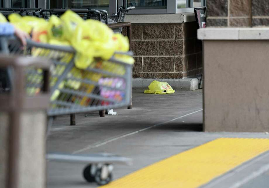 A rogue plastic bag lays on the sidewalk as people push their shopping carts on Friday, April 19, 2019 at ShopRite in Albany, NY. (Phoebe Sheehan/Times Union) Photo: Phoebe Sheehan, Albany Times Union / 40046713A