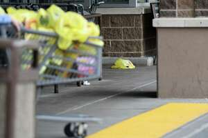 A rogue plastic bag lays on the sidewalk as people push their shopping carts on Friday, April 19, 2019 at ShopRite in Albany, NY. (Phoebe Sheehan/Times Union)