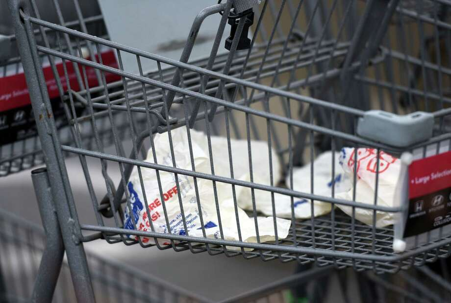 Empty grocery bags sit in a shopping cart in the Price Chopper parking lot on Friday, April 19, 2019 in Loudonville, NY. (Phoebe Sheehan/Times Union) Photo: Phoebe Sheehan, Albany Times Union / 40046713A