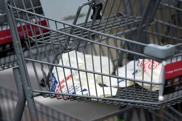 Empty grocery bags sit in a shopping cart in the Price Chopper parking lot on Friday, April 19, 2019 in Loudonville, NY. (Phoebe Sheehan/Times Union)