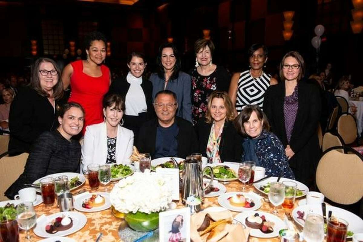 Fashion Designer Elie Tahari (pictured front, center) poses for a photo with attendees at the 2019 SEARCH Annual Luncheon on Thursday, April 18, at the Hilton Americas in downtown Houston. Tahari came to the United States with only $100 and found himself living in New York City shelters and in Central Park before going on to become one of the world's top designers.