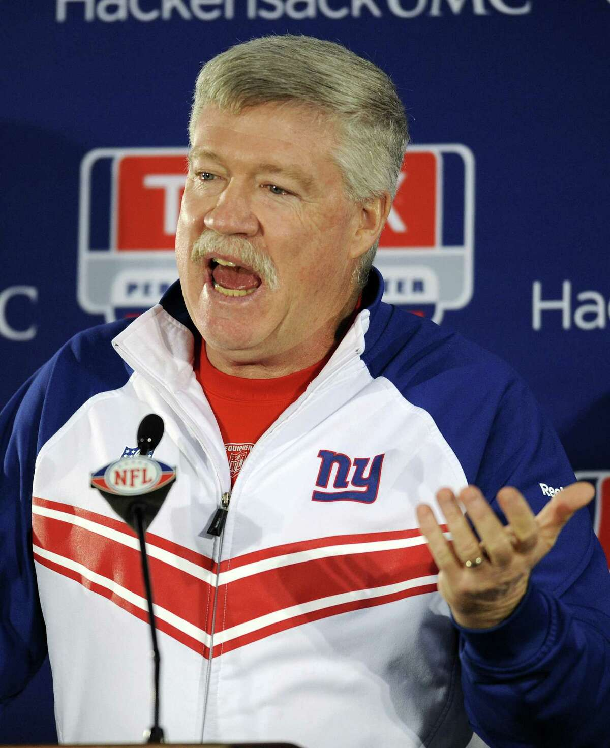 Then-New York Giants offensive coordinator Kevin Gilbride speaks to the media after NFL football practice Thursday, Jan. 19, 2012, in East Rutherford, N.J. Gilbride has been hired as the head coach and general manager of the New York team of the revived XFL, whose inaugural season will be in 2020.