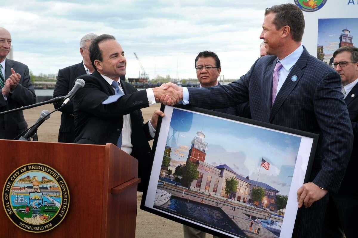 Bridgeport Mayor Joe Ganim shakes hands with developer Robert Christoph, Jr., executive vice president of Bridgeport Landing Development, at the groundbreaking ceremony for the waterfront section of Steelpointe Harbor in Bridgeport, Conn. May 15, 2017.