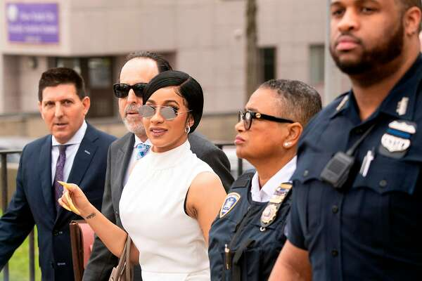 Rapper Cardi B leaves after a hearing at Queens Criminal Court on April 19, 2019 in New York City. The Grammy-nominated rapper briefly appeared in criminal court on Friday over her alleged involvement in a strip club brawl. (Photo by Johannes EISELE / AFP)JOHANNES EISELE/AFP/Getty Images