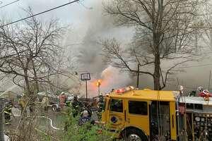 Firefighters battle blaze on Hudson Avenue in Pleasantdale on Friday, April 19, 2019.