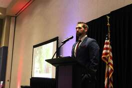 Cody Holder, Harris County Precinct 4 community aide, speaks to the crowd at the monthly Cy-Fair Houston Chamber of Commerce general membership luncheon. Holder told the crowd about the various services H
