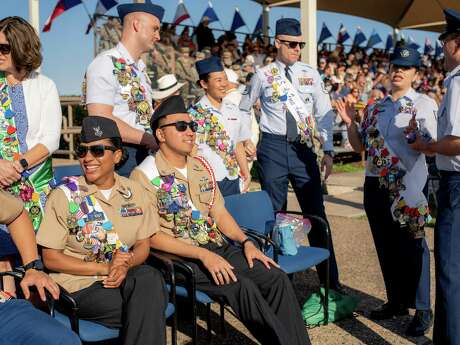 Fiesta revelers and military personnel joined together at Joint Base San Antonio-Lackland during the Fiesta Military Parade and basic training graduation in San Antonio, Texas on Friday, April 19, 2019.