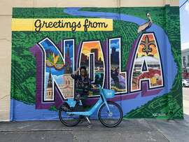 "Just before our final destination, we spotted the ""Greetings from NOLA"" mural off to the side of the road. Naturally, we had to pull over and take photos."