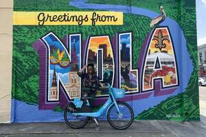 """Just before our final destination, we spotted the """"Greetings from NOLA"""" mural off to the side of the road. Naturally, we had to pull over and take photos."""