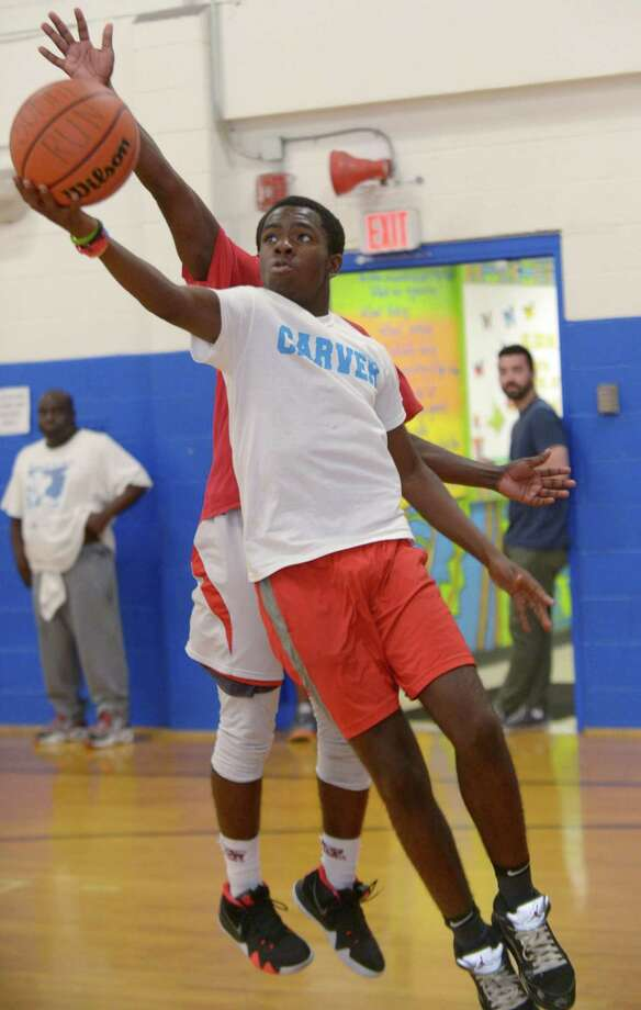 Matthew Jarrett goes to the hoop during Mo's Summer Run alumni night Friday, July 20, 2018, at the Carver Community Center in Norwalk, Conn. Improvements to the center are taking place through Community Development Block Grant funding. Photo: Erik Trautmann / Hearst Connecticut Media / Norwalk Hour