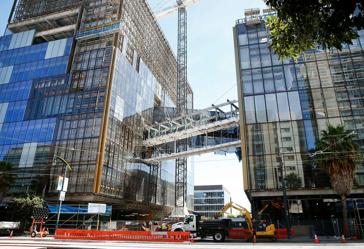 Elevated foot bridges connect two office buildings under construction that will be the world headquarters for Uber on Third Street near the Chase Center arena in San Francisco, Calif. on Thursday, April 18, 2019.