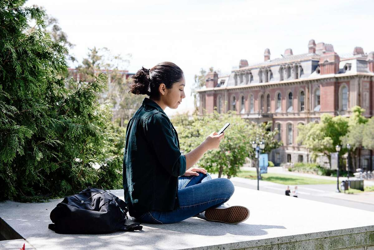 UC Berkeley sophomore student Daniela Cervantes uses her phone to send out emails between classes on the Cal campus in Berkeley, Calif, on Friday, April 19, 2019.