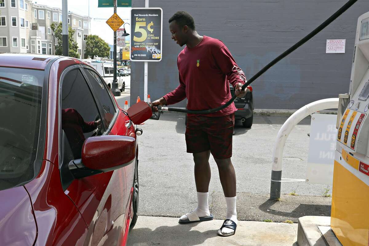 Cal state student and Lyft driver Mathayo Huma from Hayward tops off his gas at the beginning of his shift at a Shell station on 5th St. on Friday, April 19, 2019 in San Francisco, Calif.
