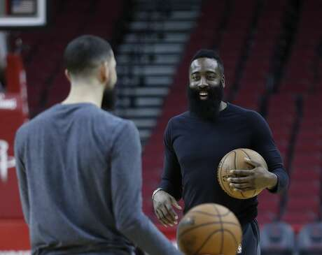 Houston Rockets guard James Harden laughs with Austin Rivers during the Houston Rockets practice at the Toyota Center in Houston, Friday, April 19, 2019, as they prepare for Saturday's game 3 NBA playoffs against the Utah Jazz.