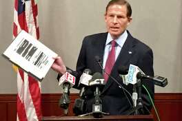 Sen. Richard Blumenthal holds up a copy of the heavily redacted Mueller report at a press conference at the state Legislative Office Building in Hartford Thursday, April 18, 2019.