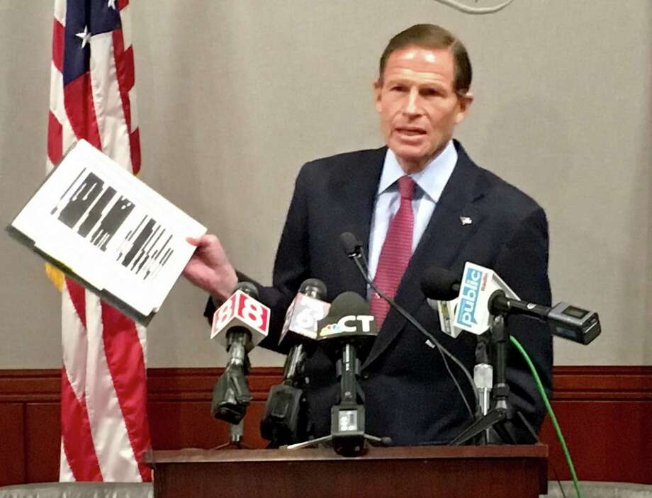 Sen. Richard Blumenthal holds up a copy of the heavily redacted Mueller report at a press conference at the state Legislative Office Building in Hartford Thursday, April 18, 2019. He's working with the Trump administration on judge appointments despite friction over the investigation. Photo: Dan Haar /Hearst Connecticut Media /