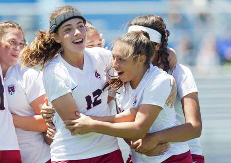 Katy Tompkins forward Barbara Olivieri, right, reacts beside defender Avery Burchett (12) after scoring a goal in the second period of a Class 6A girls state semifinal match during the UIL State Soccer Championships at Birkelbach Field, Friday, April 19, 2019, in Georgetown.