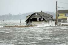 A house goes under water as Hurricane Sandy picks up speed with waves from Long Island sound and hits the Cosey Beach area of East Haven, Conn., October 29, 2012. Photo by Peter Hvizdak / New Haven Register
