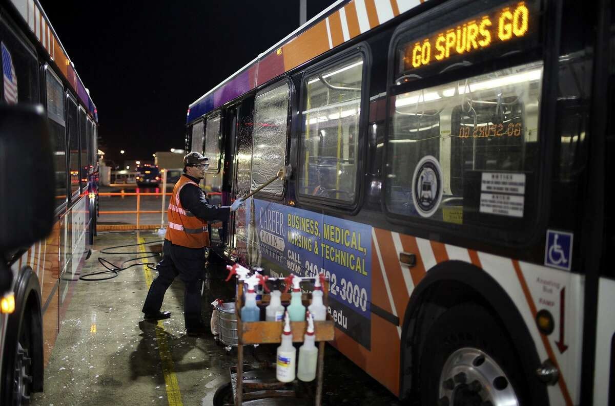VIA Metropolitan Transit employee Joseph Trevino, 42, scrubs a bus featuring an ad on Feb. 15, 2011, part of an eight hour detailing that happens every six weeks. Metropolitan Transit Authority is considering allowing advertising, possibly similar to that on VIA buses.