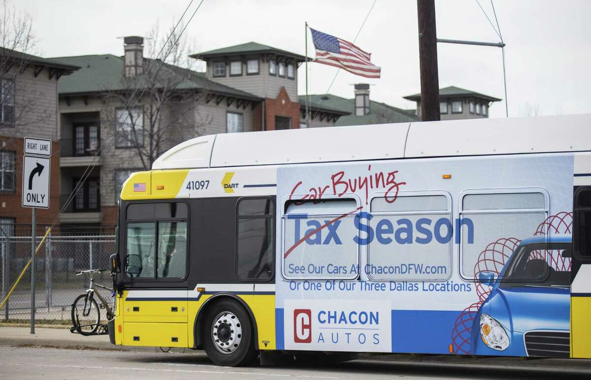 A Dallas Area Rapid Transit bus featuring a large ad on its side waits at a stop in southern Dallas on Feb. 15, 2018. Metropolitan Transit Authority is considering allowing advertising, possibly similar to that on DART buses.