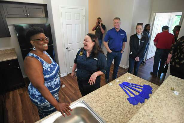 The General Land Office's Brittany Eck and Havalisia Owens, left, talk in Owens' brand new Port Acres home on Friday. Owens' home was ruined by Harvey, then demolished and replaced by the GLO. Photo taken Friday, 4/19/19