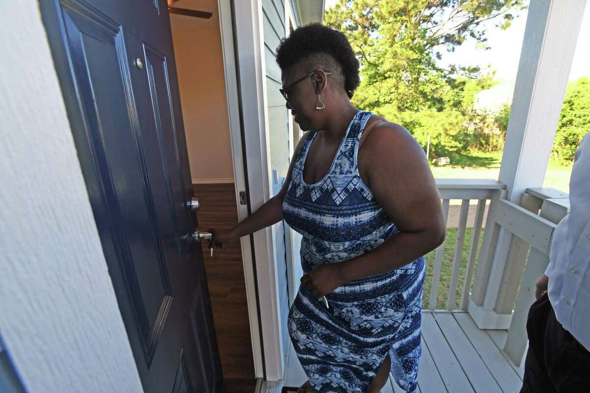Havalisia Owens walks into her Port Acres home for the first time on Friday. Owens' home was ruined by Harvey, then demolished and replaced by the GLO. Photo taken Friday, 4/19/19