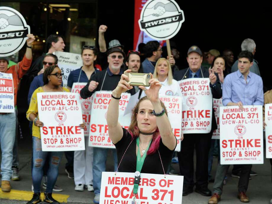 Stop & Shop employees are on strike after having been without a contract since February, and are resisting the company's attempts to cut pay, benefits, vacation and personal time. Board of Representative Nina Sherwood, center, and other Stamford representatives join with striking employees on the line Thursday, April 19, 2019 at one of the Stamford, Conn. stores asking customers to honor the strike and not enter the store. The purpose of the rally is to stand in solidarity with Local 371 and Local 919 in their demands for a fair contract, Sherwood said. Photo: Matthew Brown, Hearst Connecticut Media / Stamford Advocate