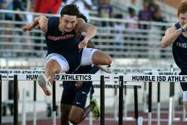 Atascocita's Dillon Potter pushes to the finish line in the Boys 110 Meter Hurdles at the 22-6A District Track Meet at Turner Stadium in Humble on April 10, 2019.