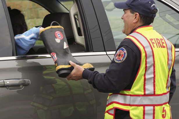 Midland firefighter Kris Morgan collects donations April 2, 2018, during the annual Fill the Boot fundraiser for the Muscular Dystrophy Association.