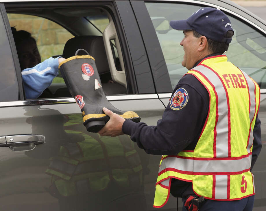 Midland firefighter Kris Morgan collects donations April 2, 2018, during the annual Fill the Boot fundraiser for the Muscular Dystrophy Association. Photo: MRT File Photo