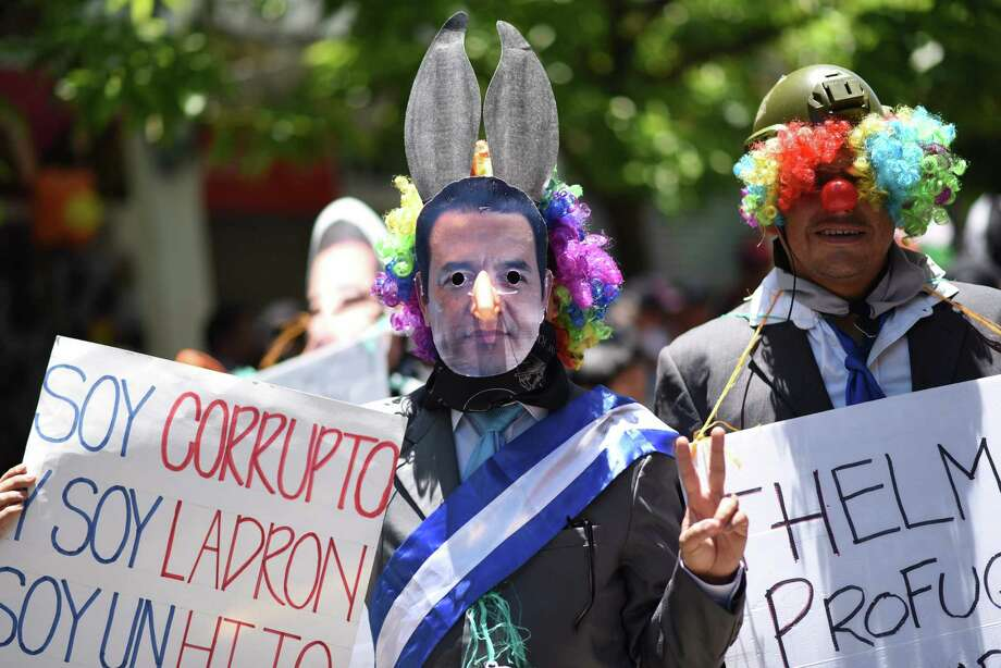 "A University student disguised as Guatemalan President Jimmy Morales takes part in the traditional ""Huelga de Todos los Dolores"" (Strike of All Sorrows) parade, that takes place during Lent, and during which students satirize and make fun of politicians, in Guatemala City, April 12. The cause of immigration to America is the overall corruption within Latin American governments. Photo: JOHAN ORDONEZ /AFP /Getty Images / AFP or licensors"