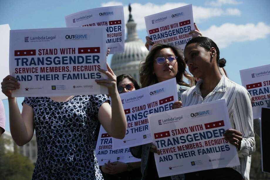 Activists participate in a rally at the Reflecting Pool of the U.S. Capitol April 10, in Washington, DC. A reader thinks the ban on transgender military recruits should be lifted. Photo: Alex Wong /Getty Images / 2019 Getty Images