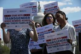 Activists participate in a rally at the Reflecting Pool of the U.S. Capitol April 10, in Washington, DC. A reader thinks the ban on transgender military recruits should be lifted.