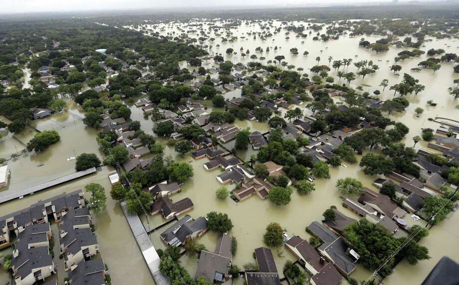 More extreme weather is one result of climate change. Hurricane Harvey certainly qualifies as an extreme event. It inundated Houston in 2017. Photo: David J. Phillip /Associated Press / Copyright 2018 The Associated Press. All rights reserved.