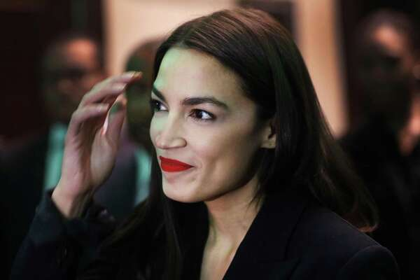 U.S. Rep. Alexandria Ocasio-Cortez, D-N.Y., prepares to speak at the National Action Network's annual convention on April 5, 2019 in New York City.