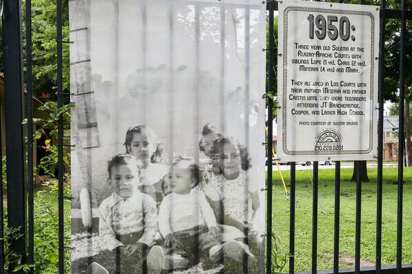 Recently installed Fotobanners of West Side residents on display at the Alazan-Apache Courts alongside Brazos St. in 2015. This public housing has served as home and shelter to thousands of families who contribute to our community's workforce, culture and vitality. The San Antonio Housing Authority is now planning more mixed-income housing on the West Side.