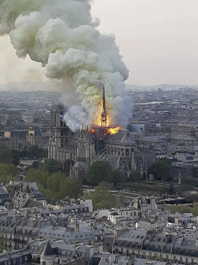 "Flames and smoke rise from the blaze at Notre Dame cathedral in Paris, Monday. An inferno that raged through Notre Dame Cathedral for more than 12 hours destroyed its spire and its roof but spared its twin medieval bell towers, and a frantic rescue effort saved the monument's ""most precious treasures,"" including the Crown of Thorns purportedly worn by Jesus, officials said Tuesday. Photo: Cedric Herpson /Associated Press / Copyright 2019 The Associated Press. All rights reserved."