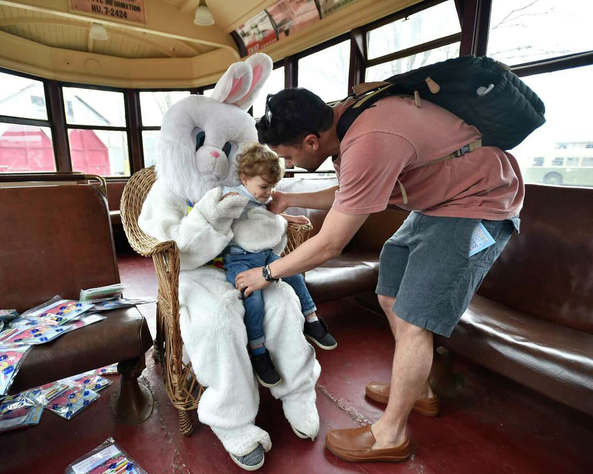 East Haven, Connecticut - Friday, April 19, 2019: Mike Boral of Fairfield helps his son Miles, 2, visit with the Easter Bunny at the Shore Line Trolley Museum in East Haven Friday, an annual event celebrating the coming of spring.