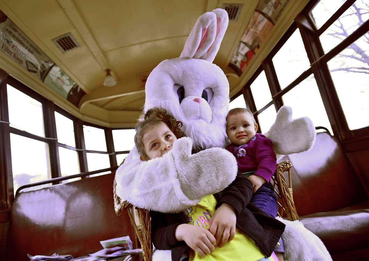 East Haven, Connecticut - Friday, April 19, 2019: Sofia Negron, 4, left, and Amelis Negron, 1, of East Haven, visit with the Easter Bunny at the Shore Line Trolley Museum in East Haven Friday, an annual event celebrating the coming of spring.
