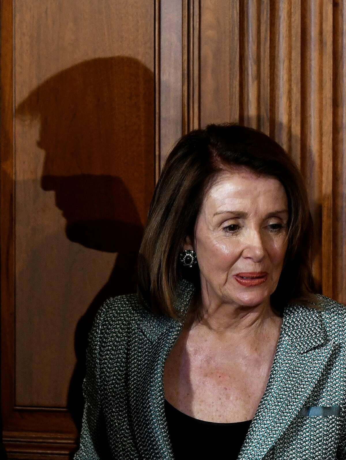 WASHINGTON, DC - MARCH 14: (AFP OUT) U.S. President Donald Trump's shadow is seen behind House Speaker Nancy Pelosi (D-CA) during the Friends of Ireland Luncheon in honor of Ireland Prime Minister Leo Varadkar at the U.S. Capitol on March 14, 2019 in Was