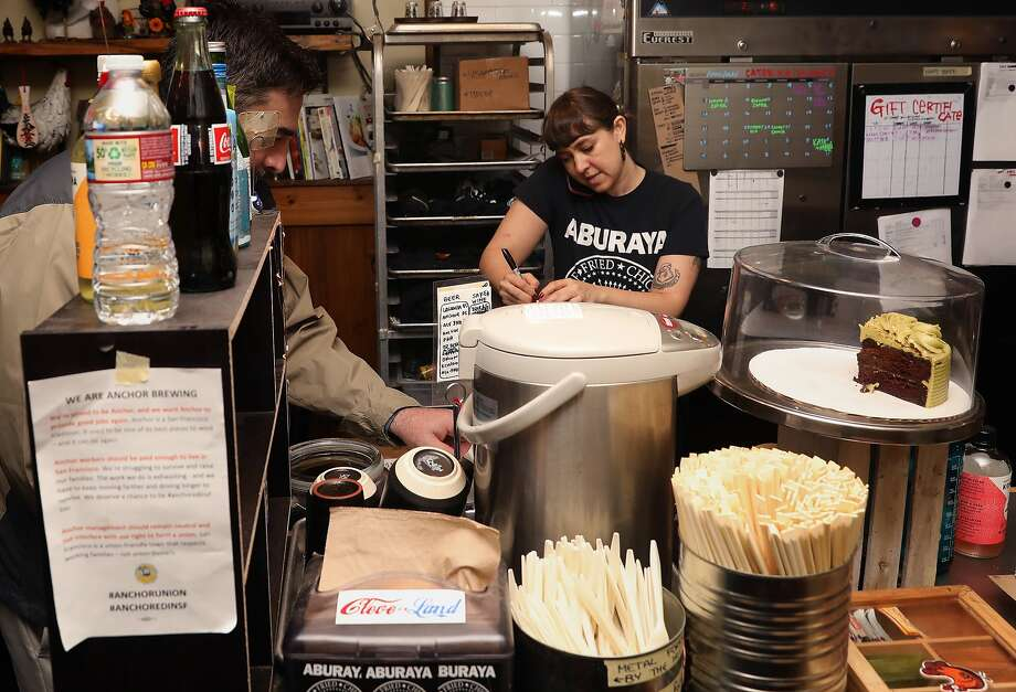 Julia Son-Wolfson (right) works the counter at Aburaya on Friday, April 5, 2019, in Oakland, Calif. Aburaya is a punk rock-themed Japanese fried chicken restaurant which started as a pop-up. Photo: Liz Hafalia / The Chronicle