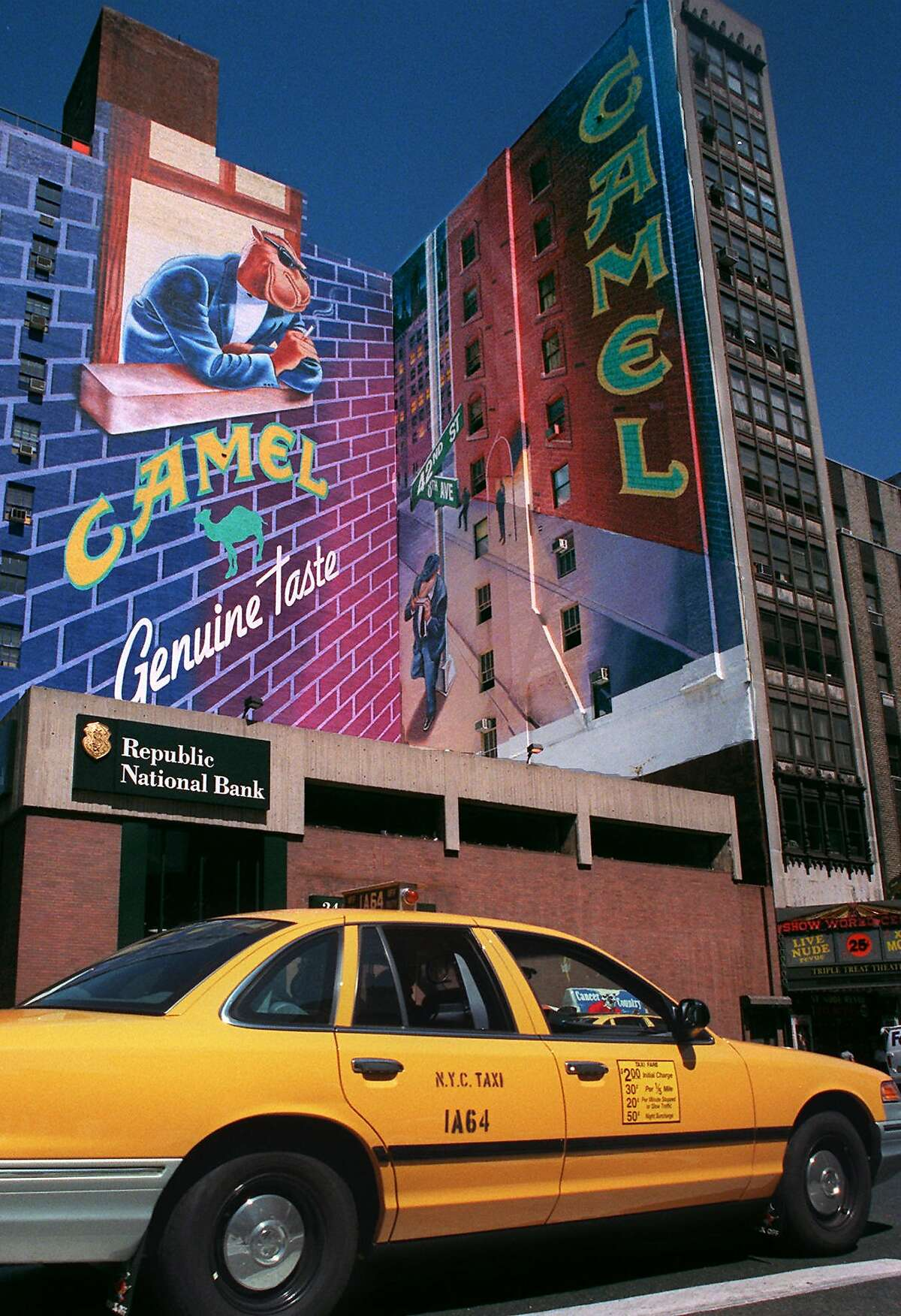 A Joe Camel advertisement is visible above New York's Times Square at 42nd St. and 8th Ave., Thursday July 10, 1997. Reynolds Tobacco Co. announced Thursday that Joe Camel, the jazzy cartoon character blamed for luring kids to smoke, is being retired and replaced by the ordinary, more lifelike camel seen on the cigarette pack label. (AP Photo/Gino Domenico)