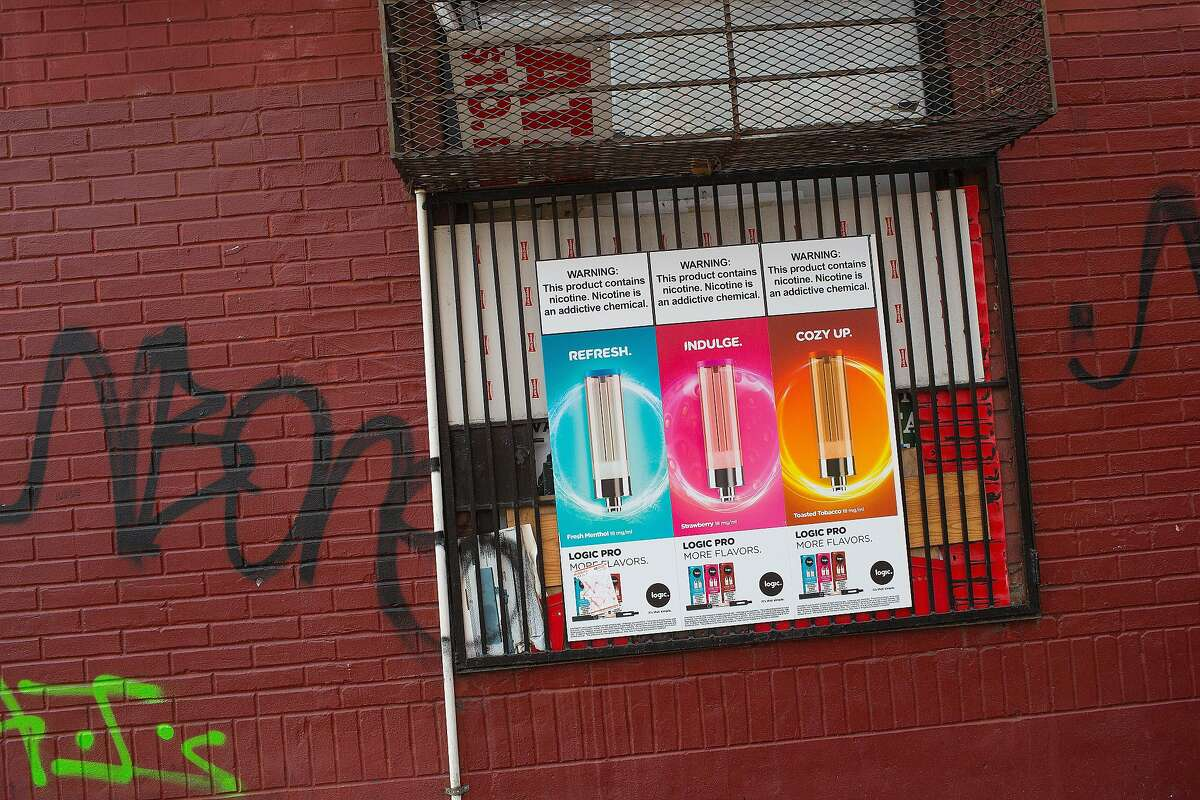 BROOKLYN NY - DECEMBER 19: A tobacco shop half a block away from the largest high school in New York actively sells Juuling products on December 19, 2018 in the Fort Greene neighborhood of Brooklyn, New York. Until a few weeks ago, this store, and others in the neighborhood, had large outside advertisements for Julling products, but the city made them move them inside the stores. (Photo by Andrew Lichtenstein/Corbis via Getty Images)