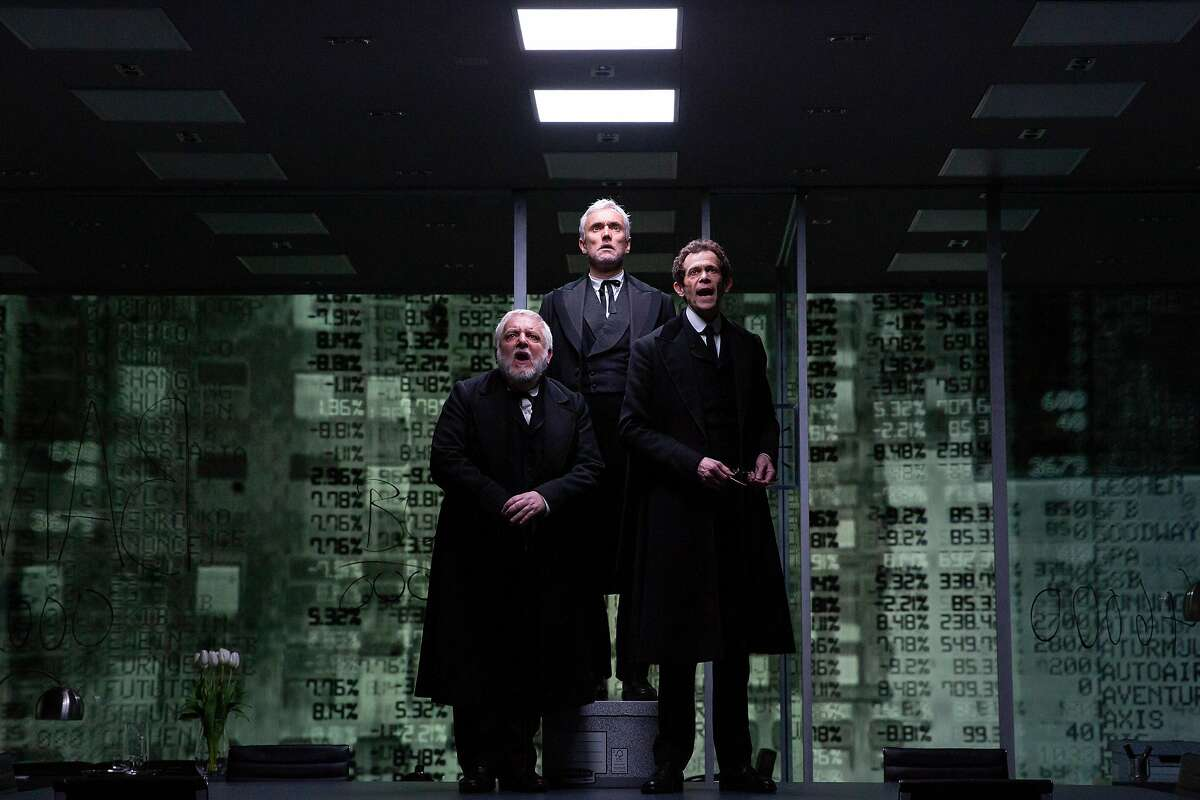 Simon Russell Beale (left), Ben Miles and Adam Godley, who play multiple roles, appear in